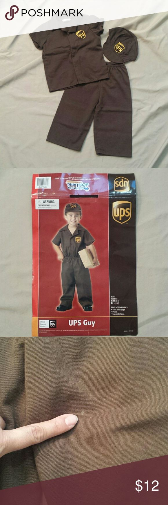 Toddler Kids UPS Guy Costume Does your son want to dress up as dad for Halloween? This is perfect if dad works for UPS! One of the best kids costumes I've ever purchased,  it is well constructed in a nice thick fabric.  65% Polyester,  35% Cotton. Elastic waist pants. Velcro closure shirt. One tiny spot on left thigh,  shown in pic 3. Brand: California Costume Collections, Inc. Costumes Halloween