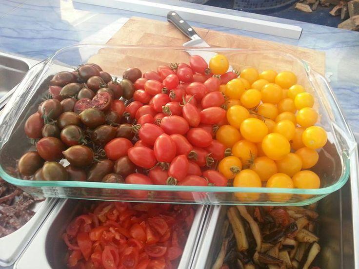 Tomatoes go Greek!  Black tomatoes from Crete, Red tomatoes from Santorini and yellow tomatoes from Syros. Marechiaro Pizza Mykonos
