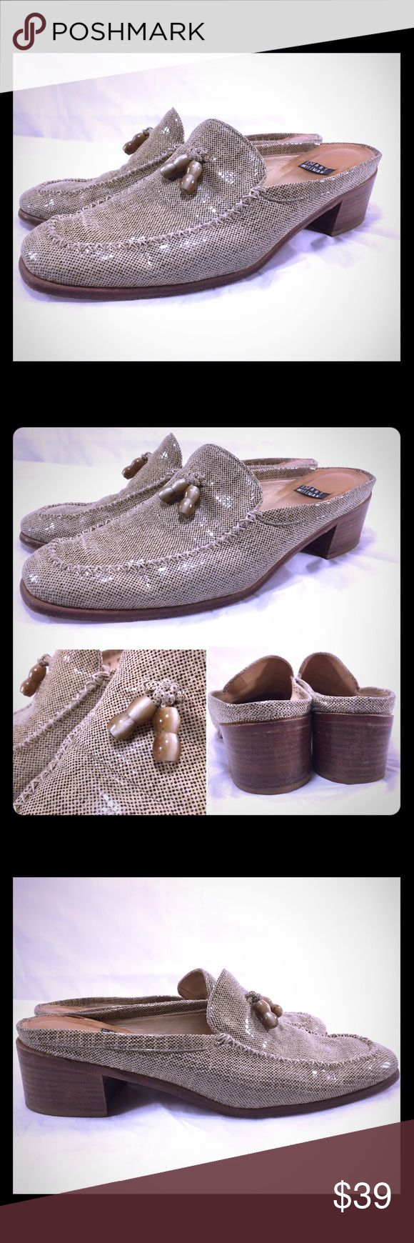 "STUART WEITZMAN Shiny Metallic/Khaki Mules STUART WEITZMAN Shiny Metallic/Khaki Mules with Tassel Detail. 9M. Originally $198. Heel measures 2.25"". Moderate wear to insole, and sole. Heels show some wear but looks nice overall. Upper looks fabulous. Stuart Weitzman Shoes Mules & Clogs"