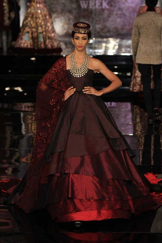 This rich collection by Manish Malhotra featured gorgeous deeply coloured silks and stunning nature theme embroidery with flowers and leaves...