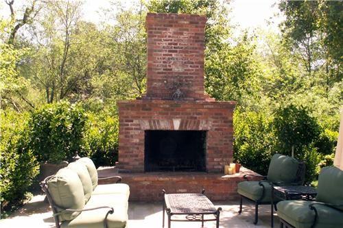 Backyard Brick Fireplace, Wood Outdoor Fireplace  Outdoor Fireplace  Grace Design Associates  Santa Barbara, CA