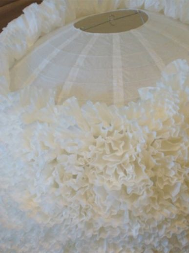 Coffee filters crumpled then glued onto an inexpensive paper lantern, looks like soft, fluffy roses.