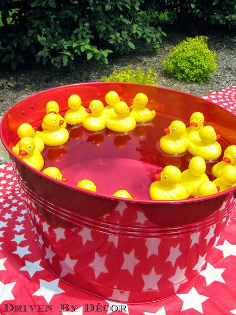 A Carnival / Circus Themed Birthday Party - Duck Matching Game - purchased from Oriental Trading Company. Twenty ducks with numbers preprinted on the bottom of them were set afloat in a galvanized tub. The girls picked two ducks at a time and checked to see if they had matching numbers on the bottom. They got a certain number of turns and earned a ticket for each match that they made.