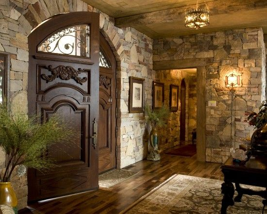 Love the rock and hard wood doors...Nice finish out for low ceiling entry - to get the most impact.
