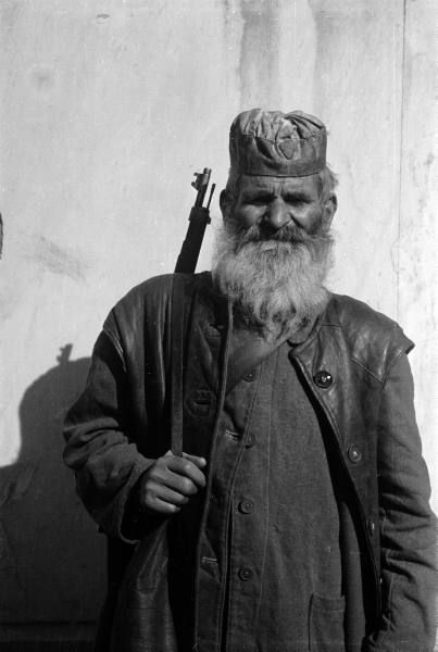 1942-1944. An orthodox priest, member of ELAS (Greek People's Liberation Army), fighting against the German, Italian and Bulgarian occupation forces.