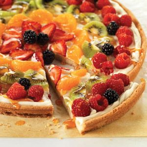 Philadelphia Fruit Pizza - refrigerated sliceable sugar cookies - 8 oz. cream cheese - sugar - vanilla - apricot preserves - 4 cups assorted fruit - kiwi - strawberries - blueberries - canned mandarin oranges