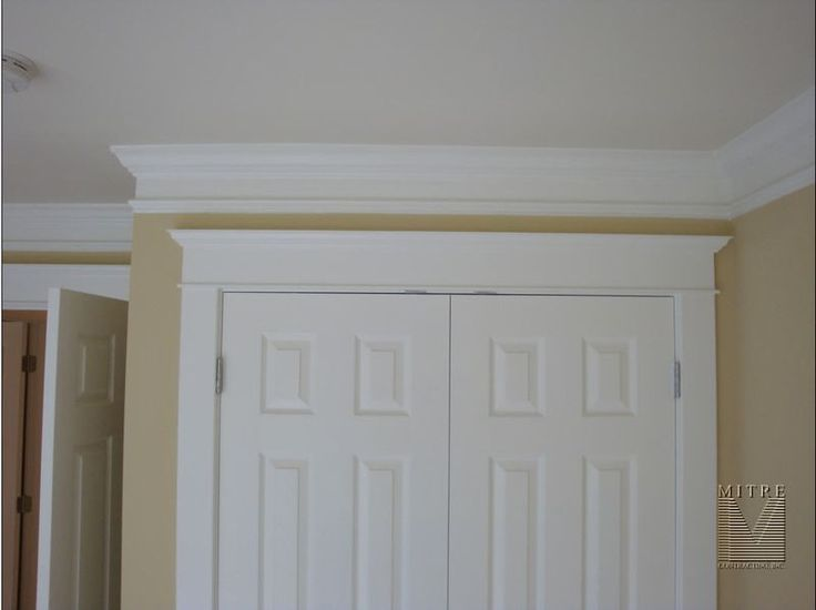 Crown Moulding Put extra trim spaced below and paint in