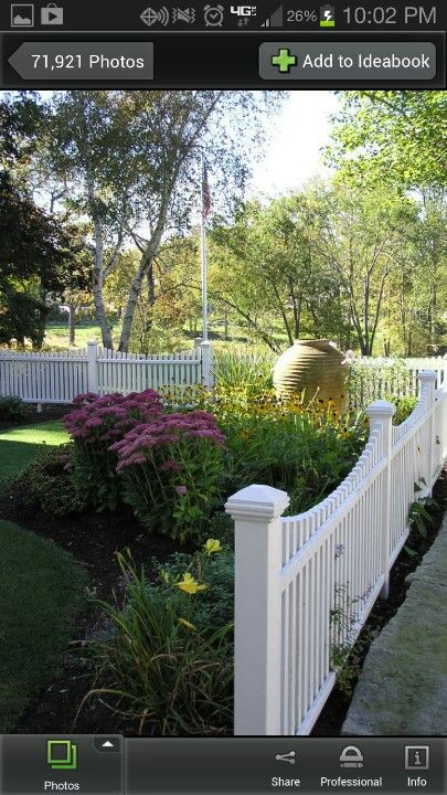 White picket Fence. Like the curve in it.