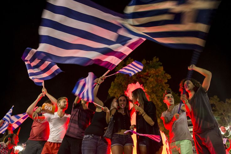 """""""No"""" supporters celebrate referendum results on a street in central in Athens, Greece July 5, 2015. ... - REUTERS/Marko Djurica"""