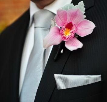 mens buttonhole featuring a pink cymbidium orchid