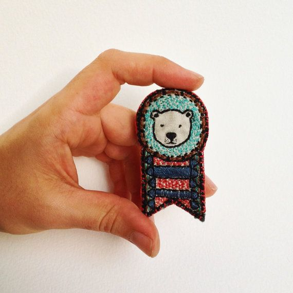 Polar bear embroidered medal brooch