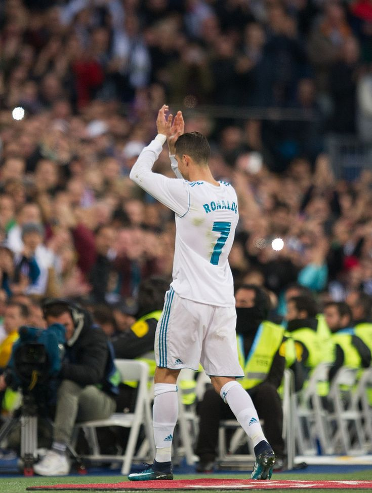 Cristiano Ronaldo Photos - Cristiano Ronaldo of Real Madrid salutes the crowd after being substituted during the La Liga match between Real Madrid and Sevilla at Estadio Santiago Bernabeu on December 9, 2017 in Madrid, Spain. - Real Madrid v Sevilla - La Liga