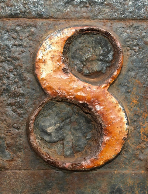 The number eight represents new beginnings according to Bernie Siegel M.D. I love the orange in the photo and the wonderful textural quality of the rust.