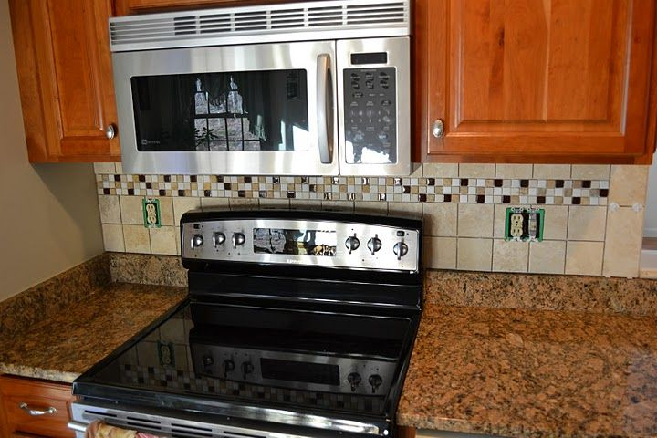 Tiled kitchen backsplash below and behind the microwave for Kitchen cabinets vernon bc