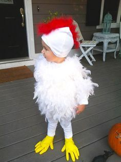 adorable chicken costume - white tights, white long sleeved tshirt, white beanie, red feathers, white feather boas and yellow rubber gloves = too easy!!