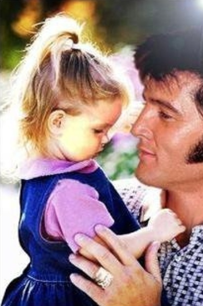 Elvis Presley with daughter Lisa...one handsome man when he was being natural in candid shots like this one.