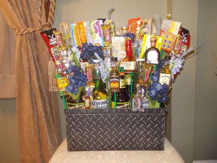 Father's Day Gift Basket -  Just made this for my step-dad for Father's Day tomorrow. Different beers, small tequila and whiskey bottles, beef jerky, candy, lottery scratch-off tickets, etc.