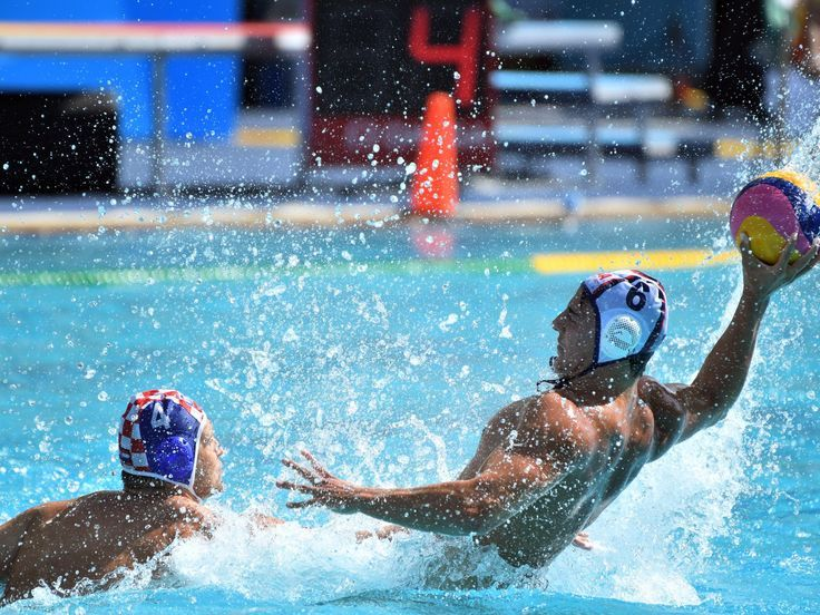 Luca Cupido of the United States holds the ball against Luka Loncar of Croatia during a men's preliminary round water polo match in the Rio 2016 Summer Olympic Games at Maria Lenk Aquatics Centre.  Robert Hanashiro, USA TODAY Sports