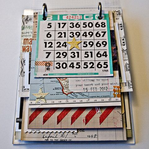 mini album made with vintage scraps on a plexiglass board with a two-ring binder mechanism. Seen on Saturday Morning Vintage's blog.