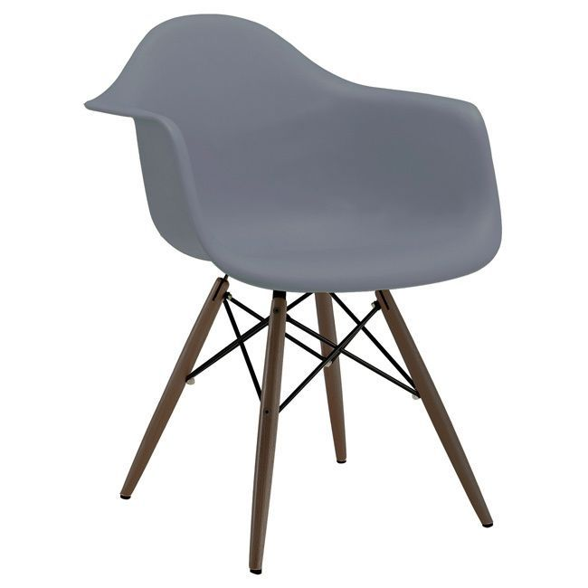 These classic arm chairs are based on the Eames DSW side chair designed in 1950 by Ray and Charles Eames. This mid-century inspired arm chair is a high quality reproduction made from polypropylene with dark brown base legs.
