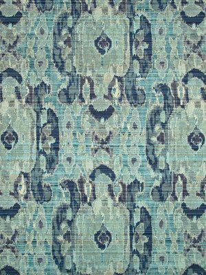 A woven ikat upholstery fabric in a traditional design of azure blue, navy blue and light green. This mid-weight durable fabric is suitable for