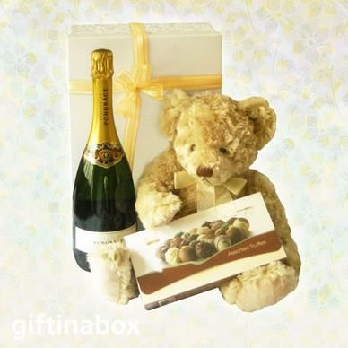 Well done proud parents! Enjoy a glass of champagne and a nibble of Belgian truffle chocolates to celebrate ... and a big, fluffy teddy for the new arrival. All lovingly wrapped in an enormous white box with gold ribbons and bows.   Fluffy teddy bear (30cm) 125g Belgian truffle chocolate box Bottle of Pongracz sparkling wine