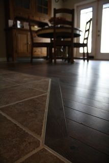 Transition from wood to tile-considering taking out our carpet..this is great!