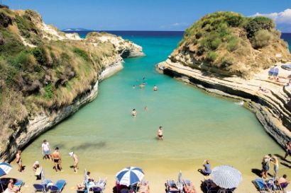 Sidari Corfu, my favorite beach! Cover your body with the mud from the rock and bask in the sun!