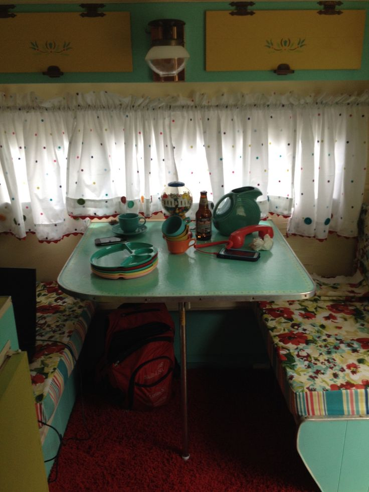 Vintage camper interior.  Cute, but not sure I want to take my Fiestaware camping. . .
