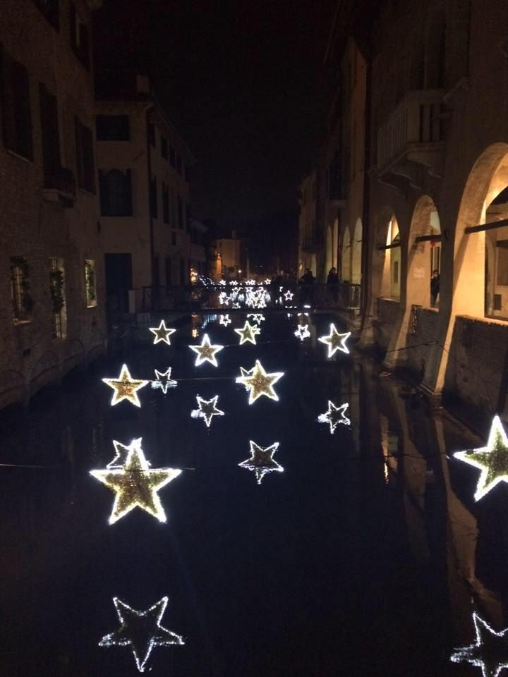 Arches and Christmas stars, Italy (by Inspired by Italy)