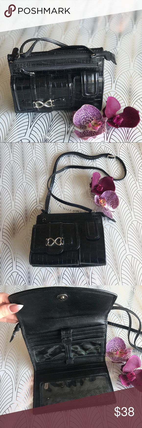 Vintage black patent leather Brighton purse wallet Totally vintage black patent leather crossbody organizer purse from Brighton, complete with cell phone slot the perfect size for your old Nokia flip phone or your favorite lipstick! No need to carry a wallet, this bag has it all, from coin purse and credit card pocket to checkbook holder and ID slots. Beautiful floral liner and silver heart accents. Handbag is in good vintage condition. All zippers function, no rips or tears. Bag measures…