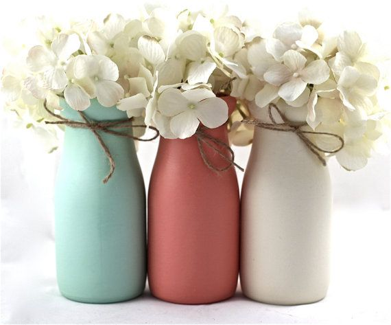 Mint and coral, these painted milk bottles will be the perfect addition to Henley's nursery