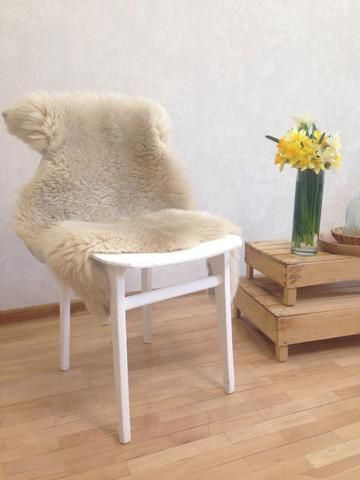 """The perfect kitchen or dining room real fur throw. Classic Beige Sheepskin Throw. East Perry's Large """"LuBlu"""" Throw, Knitted Gotland Throw sitting pretty in this beautiful modern living room. Perfect for your modern home interior, boho home and decor, or nursery decor. Check the link for full product info."""