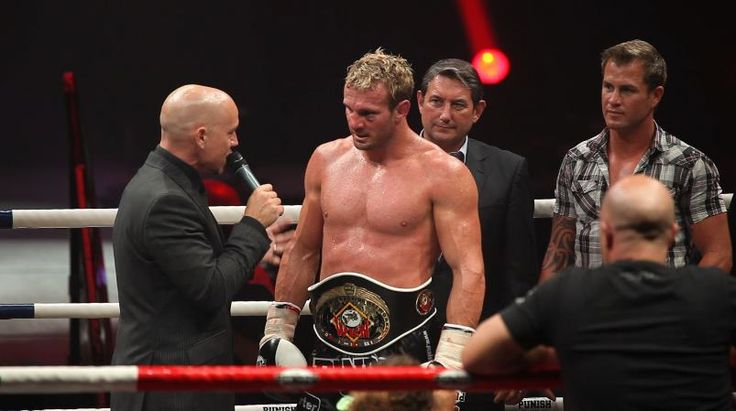 Interviewing Nathan 'Carnage' Corbett after winning his 9th World Muay Thai Title.