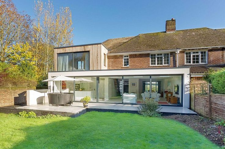 Rear extension replaces workers cottage and extends the living space into the garden Classic English Home with Brick Façade Acquires a Nifty Modern Extension