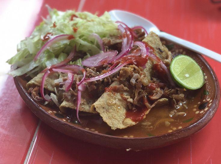 [I Ate] Tacos ahogados (drowned tacos) of carnitas with salsa roja.