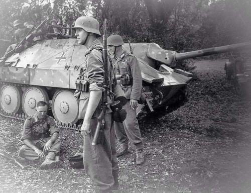 German troops and a  Hertzer t38 light tank destroyer, with a 75mm Pak-39 main gun.
