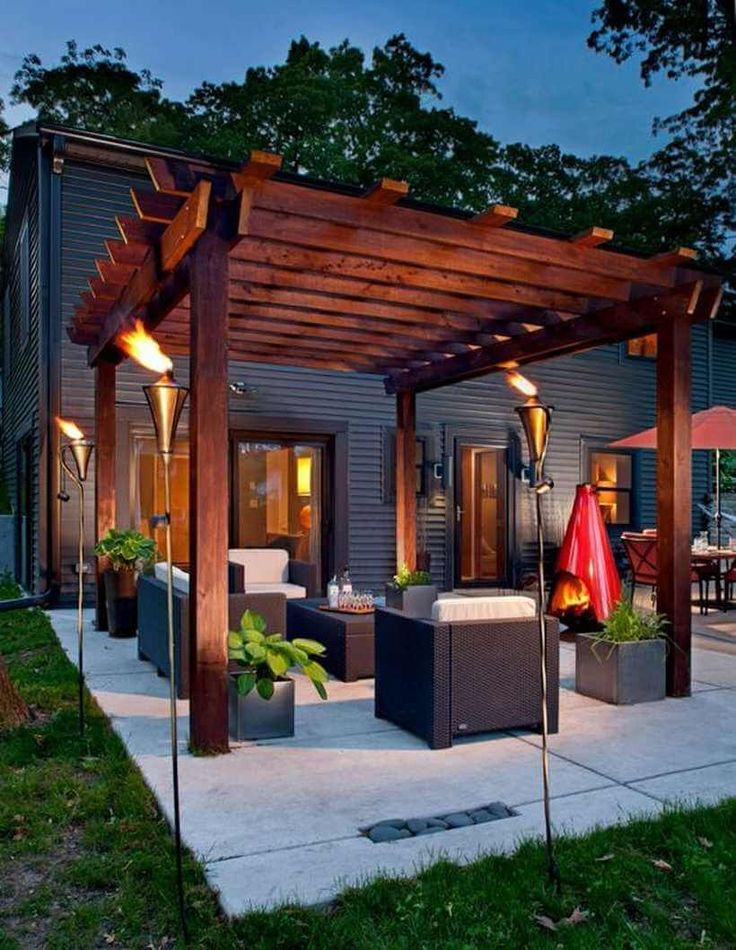 This pergola design picture is meant to show you that how you can build a beautiful wooden pergola over a patio. If you are fortunate enough to have a stunning outdoor sitting area then this pergola on the patio will make your outdoor sitting more enjoyable for you. #pergola #pergolaideas #pergoladesign #pergolaplan #pergolas #garden #gardendesign #gardenideas #patio #outdoor #outdoorliving #patiodesigns #outdoorspace #patiolayout