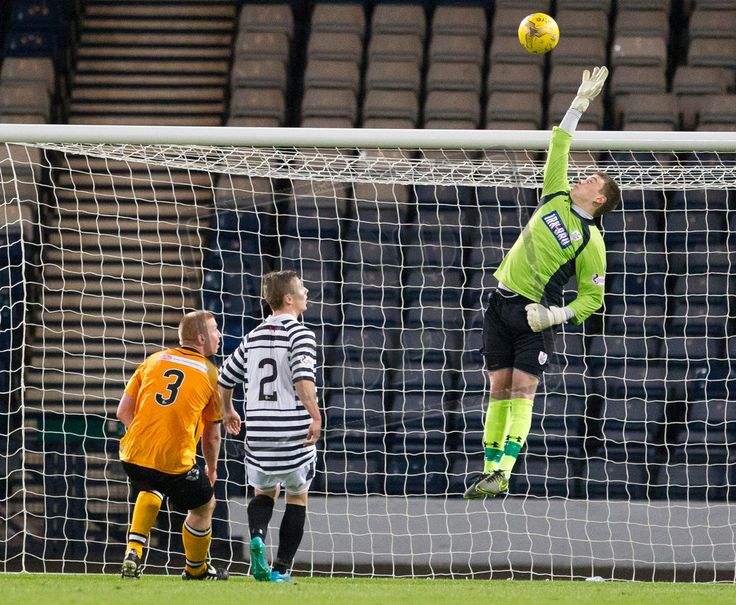 Queen's Park's keeper Wullie Muir pushes the ball away during the SPFL League Two game between Queen's Park and Annan Athletic.