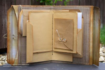 """Envelope Journal..... """"She used a selection of envelopes just folded or glued on to one another, all layered up in a fun way, stitching them into place. She cut the envelope bottoms off to create a pocket at both ends."""""""