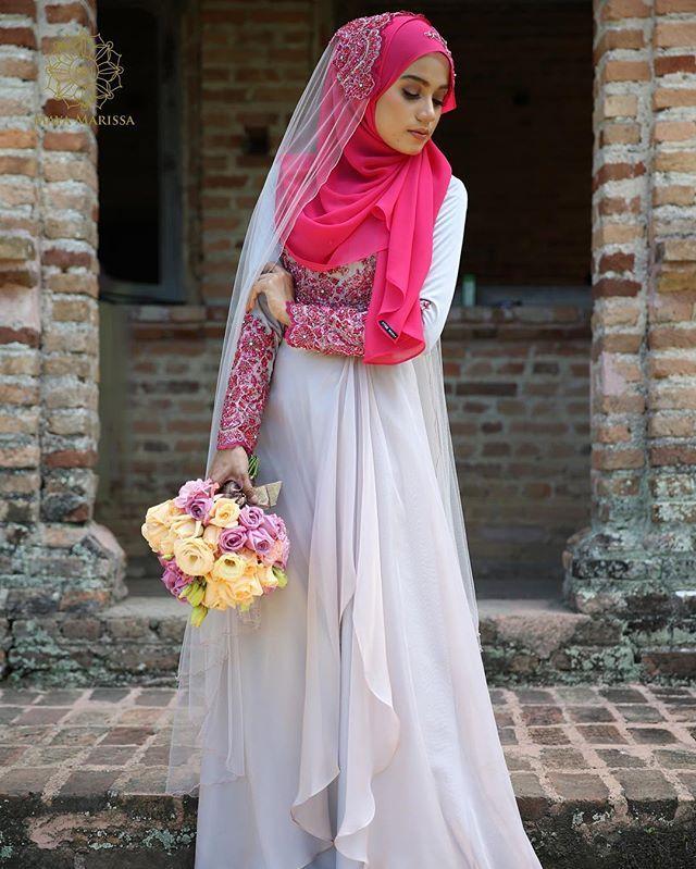 Diana Dress dari @mayamarissa.co tampil anggun dengan kelembuatan warna grey yang memukau, kombinasi material satin berkualiti tinggi dan chiffon yg eksklusif beralun cantik penuh dramatik. Sempurna dengan hiasan beads pink dengan perincian batu swarovski yang indah.  #mayamarissalaunch #lace #dresses #wedding #event #lace #couture #hautecouture #life #model #hijabista #tunang #longdress #beautiful #inspiration #inspired #malaywedding