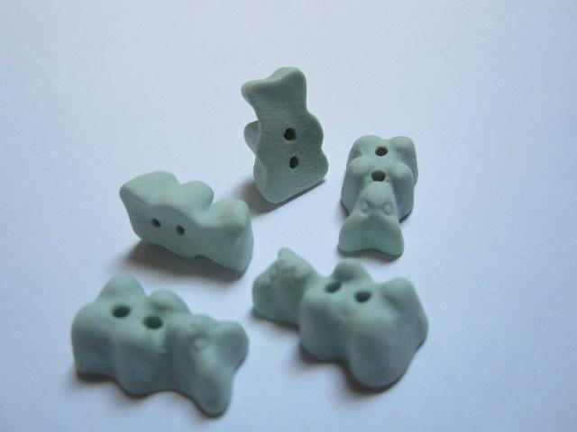 Hand made porcelain gummy bear buttons.