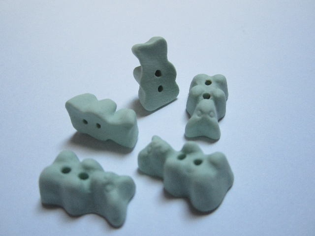 Hand made porcelain gummy bear buttons.