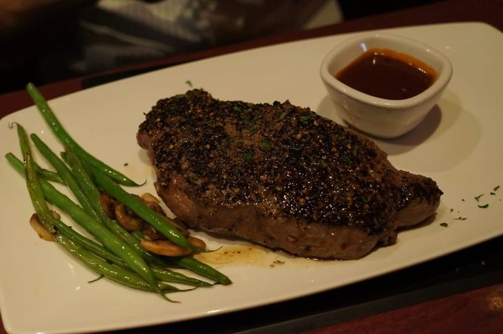 PEPPERCORN STEAK  Fleming's Prime Steakhouse Recipe   Serves 5   2 1/2 tablespoons black peppercorns  2 1/2 teaspoons white peppercorns  ...