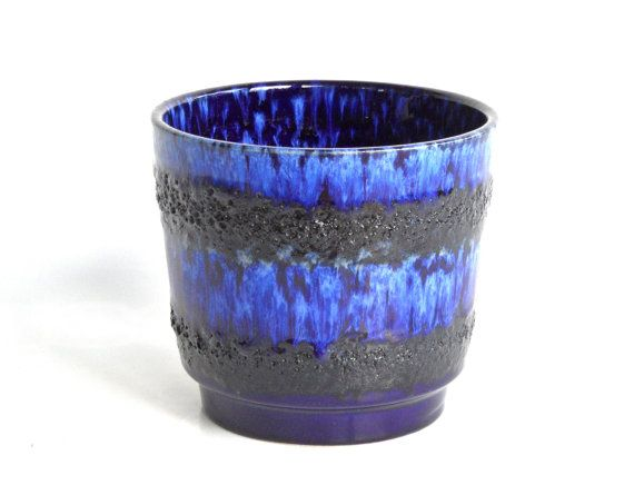Hey, I found this really awesome Etsy listing at https://www.etsy.com/uk/listing/246587253/blue-plant-pot-west-german-pottery