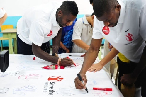 Beijing - Abou Diaby and Johan Djourou at a Save the Children event. #ArsenalTour2012