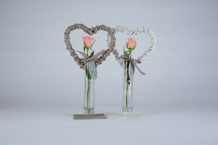 """Though times may come but love stands firm"". This hearts stand can hold a single flower. Great for a wedding favor."