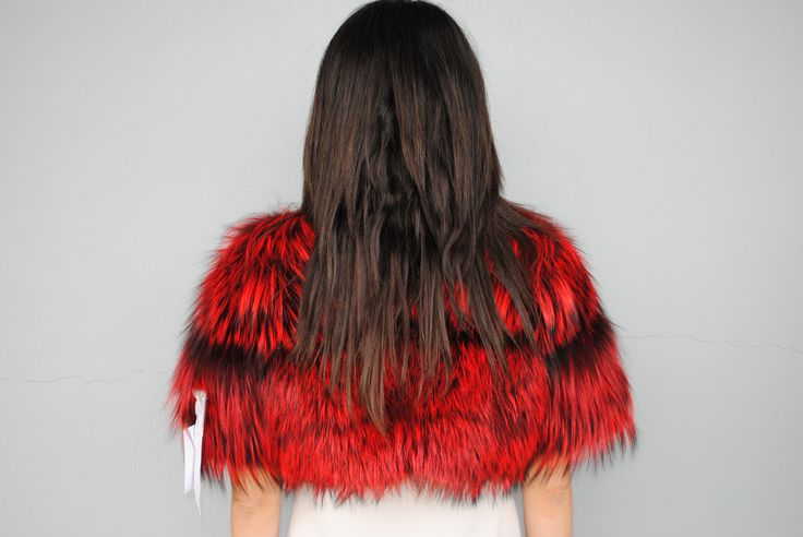 Get yourself immersed in the colour culture of fur with this edgy red coloured small fox vest.