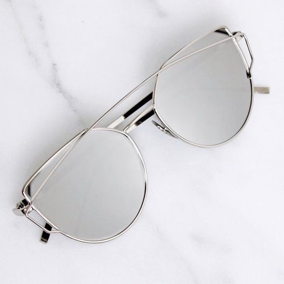 Silver Cateye Mirror Sunglasses A must have for unique sassy sunglass lovers! Love these so much I kept a pair for myself. Brand new - no tags. Silver metal sunglasses with silver mirrored lenses. With metal temples and nosepads. SLVC06164. Photos are my own. •Price is firm, not accepting offers. ❌No trades ❌No PayPal ❌No asking for the lowest price Accessories Sunglasses