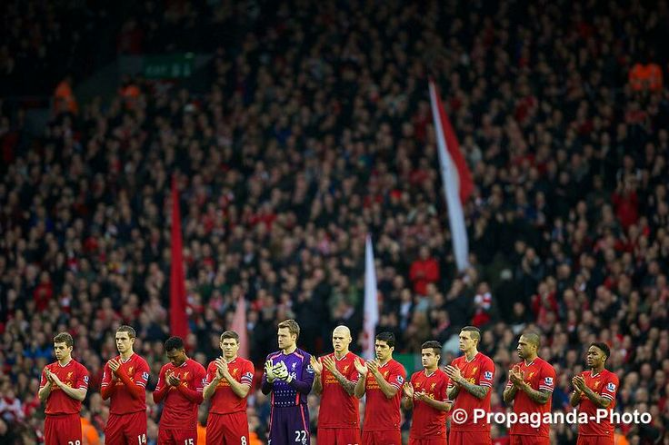 Liverpool players stand to remember Sir Tom Finney in front of the Spion Kop. #LFC